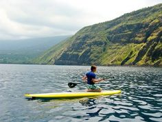 Stand up paddle boarding in Kona HI is easy to learn and it gives you a unique perspective on the waves and ocean. We offer both lessons and rentals. Yacht Vacations, Surfing Tips, Sup Yoga, Standup Paddle Board, Sup Surf, Big Island Hawaii, Big Waves, Paddle Boarding, Underwater