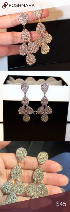 Drop Earrings These standout shimmering drop earrings effortlessly elevate all sorts of ensembles. Material: rhinestone Metal: alloy Jewelry Earrings