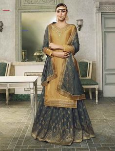 Beige Gray Embroidered Satin Silk & Jacquard Silk Sharara Designer Suit (Semi-Stitched) - #shararadesigns - Product ID: 7410-RBQ13967 Productis delivered Semi-Stitched (Unstitched) It can be custom-stitched upto bust Size 42 inches Work Type: Zari,Resham Embroidery, Cording, Sequins & Stones Work Top Color:            Beige Bottom Color:         Gray Dupatta Color:         Gray Fabric of Top:          SatinSilk Bottom Fabric:       … Sharara Designs, Sari Blouse Designs, Kurti Designs Party Wear, Lehenga Designs, Indian Wedding Gowns, Pakistani Bridal Wear, Pakistani Dresses, Wedding Dresses, Salwar Kameez