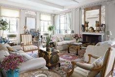 AD100 decorator Michael S. Smith was inspired by 18th-century France when he decorated the elegant Manhattan duplex he shares with HBO executive James Costos. The walls display an Ellsworth Kelly lithograph and an antique overmantel mirror, while Louis XV–style canapés, a Jansen sofa, and Louis XVI–style gilt-wood fauteuils mingle with a Chinese low table and Japanese lacquer robe chests. The decorative woodwork is by Féau & Cie.