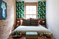 Though these bedrooms be tiny, they don't skimp on style, like this space with exposed brick and bold, tropical curtains. Here are 19 more tiny bedrooms to draw ideas from.