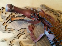 Discover a variety of prehistoric art & accessories of the ages. Bring the past back-to-life by building your own leather fossils, featuring Skelosaurz water-forming dinosaur kits, by Paleo Leather Sculpture Studio. Dinosaur Skeleton, Dinosaur Fossils, Natural Toys, Leather Art, Prehistoric, Crocodile, The Past, Skull, Sculpture