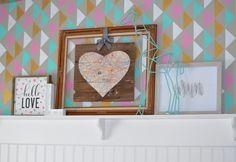 A DIY stenciled girl's nursery wall using the Triad Allover Stencil from Cutting Edge Stencils. http://www.cuttingedgestencils.com/triad-pattern-stencils-for-diy-home-decor.html  #cuttingedgestencils #stencils #stenciling #wallstencil #diy #stencilednursery #nursery #triadstencil #geometric