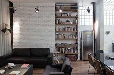 Black sofa set, white bricked wall, book shelf
