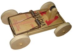 Franklin Phonetic School- Rat Trap car from my first years as a wood shop teacher.  7th and 8th graders would make these and we drew car body's on manilla folders.  Complete with gluing tabs, the body fit over the vehicle to create mostly 4 X 4 trucks and low riders that were very popular at the time.  The wheels on this vintage model had to be remade since the first ones were scavenged for another project years ago.   http://woodworkingteachers.com/default.aspx?g=posts