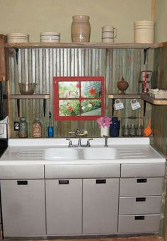 Anyone remember these types of Kitchen sinks with metal cabinets ???  Think 1950's .....