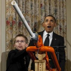 "Barack Obama reacts as Joey Hudy, 14, of Phoenix, Arizona fires a marshmallow from his ""Extreme Marshmallow Cannon"" during the White House Science Fair"