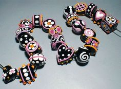 """Lampwork 101 for jewelry. I wanted to show you an example of what to look for in really good quality artisan lampwork beads. These beads are by """"Bluff Road Art Glass"""" and they are some of the very best in regards to quality and execution (and some of the highest priced). Even if this style or color isn't for you, look at the dots, see how perfectly uniform they are. The dots and raised stringers (raised lines of color) are well attached and not in any danger of popping off."""