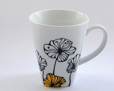 Hand painted flowers mug Custom mug Coffee mug Tea by atelierChloe Gift Ideas Hand painted mug with flowery design coffee tea mug mother's day gift unique hand painted design mothers gift for best friend Painted Coffee Mugs, Hand Painted Mugs, Pottery Painting Designs, Paint Designs, Cappuccino Tassen, Diy Mugs, Vases, Painted Wine Glasses, Posca