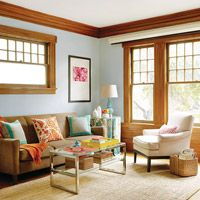 Living Room Makeover for Less -- make the oak trim work for you by incorporating it into the color scheme.  A little blue paint on the walls goes a long way to make this room look warm & inviting.