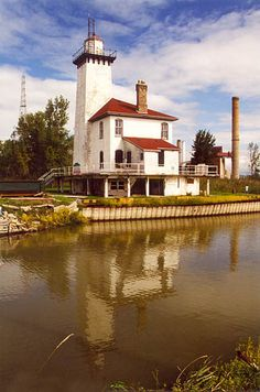 Saginaw River Lighthouse,  located just north of Bay City, Michigan on the western bank of the Saginaw River where it empties into the bay--LHF-history