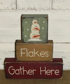 I have painted this Flakes Gather Here snowman winter block set in a light green, spice tan, and barn red with black underneath the topcoat. They have been distressed all over for more of a primitive look.  Cute shelf sitter for your Christmas and winter home décor. Measures approx. 8 x 9high