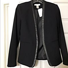 Gorgeous faux Leather detail blazer! Nice fully lined tailored jacket- open style with faux leather trim and faux front pockets. Follow me on Instagram @kfab333 for more items Jackets & Coats Blazers