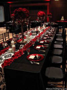 black and white table setting, black and white wedding decor reception, red flower arrangement, red flower centerpiece