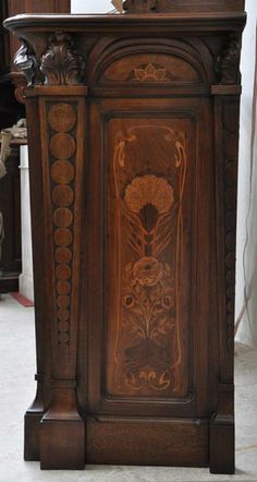 Rare Art Nouveau fireplace in wooden marquetry with snails decoration