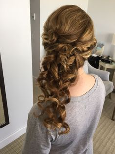 Cascading curls, side pony, bridal hairstyle