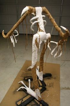 Grim Hollow Haunt :: some great DIY tips on this blog.  The fingers and feet on this one made from wire coat hangers and duct tape...