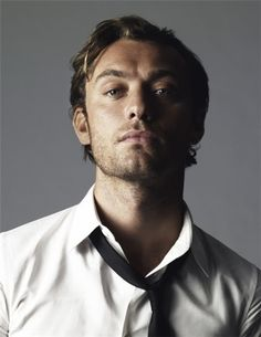 Jude Law- Displaying the sexiness of an askew tie, a button un-done...it's the little things...the arch of his neck...
