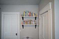This is the perfect place to tuck some bookshelves in the nursery!