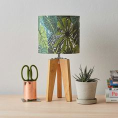 Our botanical lampshade features a plant pattern inspired by urban gardens.  Printed on high-quality 100% cotton and handmade to perfection in London. Original illustration by James Barker.  Fits standard UK & EU lamps Measures 20 cm in diameter x 18 cm in height Suitable for lamp fitting Lamp not included Dispatched within 3 working days International delivery available
