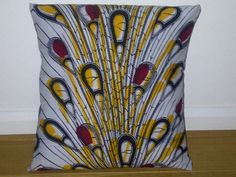 Blue Yellow & Red African Wax Print Ankara Pillow Cushion in peacock feathers pattern by AnkaraLampshades. Matching lampshade available too online