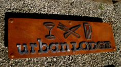 www.saltspringcnc.com. Rusted metal sign cut on water jet . Polished symbols and letters welded on standoffs. Clear coated.