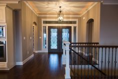 Double doors at drama to any entry way especially when paired with a large transom and sidelights as seen here