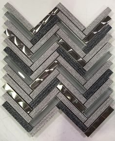 Unique Design Solutions is a decorative custom mosaic tile distributor that offers an all-inclusive door to door pricing model for authorized dealers. Herringbone Tile Floors, Grey Floor Tiles, Mosaic Tile Designs, Mosaic Tiles, Masculine Kitchen, Masculine Bathroom, Grey Kitchen Tiles, Metal Tile Backsplash, Gray Shower Tile