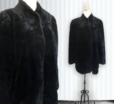 ~ Beautiful Black faux fur jacket ~ Straight style with shoulder pads ~ Side pockets, lined with black satin. ~ front hooks ~ Stand up collar ~ Very