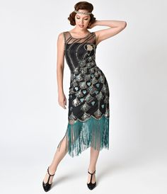 Elegantly extravagant, the Antoinette Flapper is an exquisite black mesh flapper dress fresh from Unique Vintage. Hand beaded in ornate peacock flair complemented by stunning deco sequin feathers. A sleeveless, semi-fitted silhouette is authentic to Vintage Outfits, 1920s Outfits, Komplette Outfits, Vintage Dresses, Beaded Flapper Dress, 1920s Dress, Flapper Dresses, 1920s Style Dresses, 1920s Cocktail Dresses