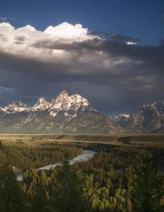 ✮ Clouds hang over the mountains of Grand Teton National Park as viewed from the Snake River Overlook