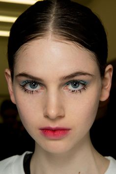 lynweiscz: Prada Fall Winter 2014 2015 Backstage Makeup by Pat McGrath Clumpy lashes everyone Stained lips and blue eyeshadow everyone