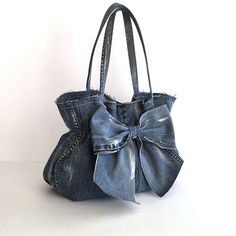 Hey, I found this really awesome Etsy listing at https://www.etsy.com/listing/502622137/jean-purse-recycled-denim-bow-bag-blue