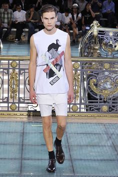 Spring 2011 The pants that ended in puddles of fabric were from an old show, and the photographic collages he deployed were in the vein of another longtime collaborator, Antwerp artist/writer Peter de Potter. http://www.style.com/fashionshows/review/S2011MEN-RSIMONS