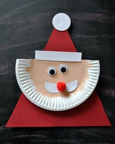 http://www.iheartcraftythings.com/2014/11/paper-plate-santa-claus.html