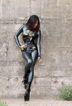 The latex suit and shoes are completely impractical; there's no way in hell she could run around and fight crime in this skin tight latex outfit with 3 foot tall heels. But damn, this cosplayer looks good as Batgirl standing against a wall, that's all I think she's able to do... stand against the wall. Way to go!