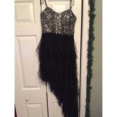 Black Formal/Prom Dress Black high-low prom dress. Top is sequins, bottom is ruffles. Size 7. Worn once. Blondie Nites Dresses