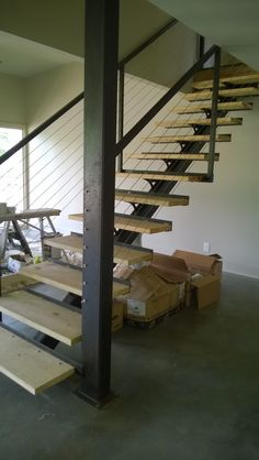 Custom single stringer staircase, posts, and cable railing