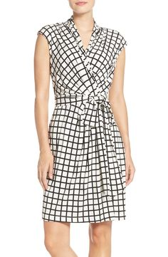 Figure-flattering gathers give graphic dimension to this comfortable windowpane-check dress.