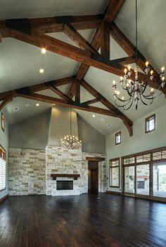 Dining room - family room - living room in one.  Limestone fireplace - Douglas fir beams. Built by Olson Defendorf Custom Homes, Austin, Texas.