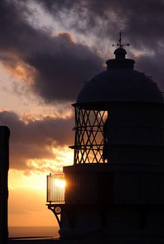 *Lighthouse in the Setting Sun