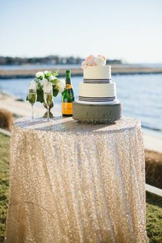 Such an amazing view! Wedding cake and champagne by the sea #gold #wedding #decor #cake #beachwedding