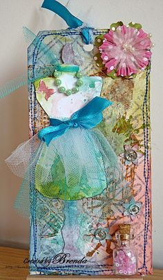 Bumblebees and Butterflies: Dress form tag. Background was created by stamping masking tape, inking with Distress inks, stamping images & adding tissue paper 2/11/12