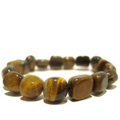 "Tigers Eye Bracelet 13 Stretch Chatoyant Brown Natural Crystal Healing Gemstone 10mm I Dig Crystals. $30.00. Stone Properties: Tigers Eye for confidence in business. Measures: approx 7""L x 10mm (stretches). Chakra: Root Chakra, Solar Chakra. Limited-Edition: handmade gifts made in USA, may vary slightly from pictures. Art Jewelry: natural tigers eye gemstone stretch bracelet"