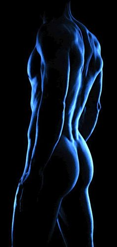 Blue light special...male figure I can almost see wings growing out from the shoulder blades