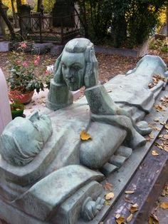 The odd grave of Fernand Arbelot, musician and actor who lived from 1880-1942. His fondest wish in death was to continue to be able to see his wife Pere's face, whose head he holds for eternity. He is buried at Lachaise Cemetery, Paris, France.
