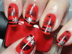 Spider nail art on red background.