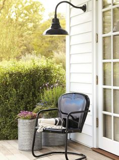 Rejuvenation Summerize Sweepstakes: classic black outdoor metal chair + warehouse light = stylish porch