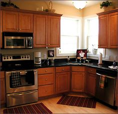 I already have a similiar stove, I love the black granite countertops!  (I love the microwave range hood too!)