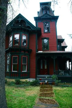 Really cool idea to paint your house - Victorian gothic red and black